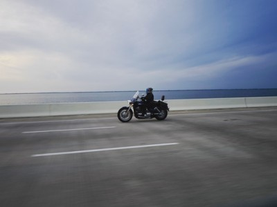 Motorcycle rider on a bridge