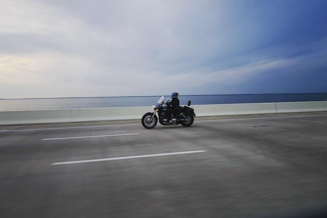 Motorcycle rider on a bridge