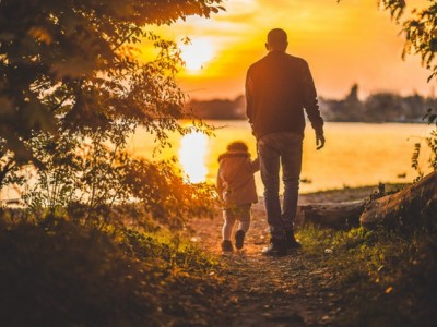Grandpa and Grandson walking at sunset