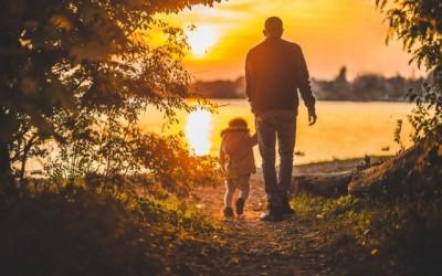 Grandpa and Grandson walking at sunset